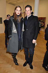 BLAISE PATRICK and TIJANA TAMBURIC at the opening private view of 'A Strong Sweet Smell of Incense - A portrait of Robert Fraser, held at the Pace Gallery, Burlington Gardens, London on 5th February 2015.