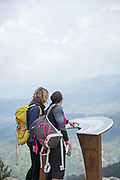 Hikers at Col de Bavella looking at view in mountains. Corsica, France