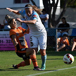 BRISBANE, AUSTRALIA - DECEMBER 4: Amy Jackson of the City is tackled by Katrina Gorry of the Roar during the round 5 Westfield W-League match between the Brisbane Roar and Melbourne City at AJ Kelly Field on December 4, 2016 in Brisbane, Australia. (Photo by Patrick Kearney/Brisbane Roar)