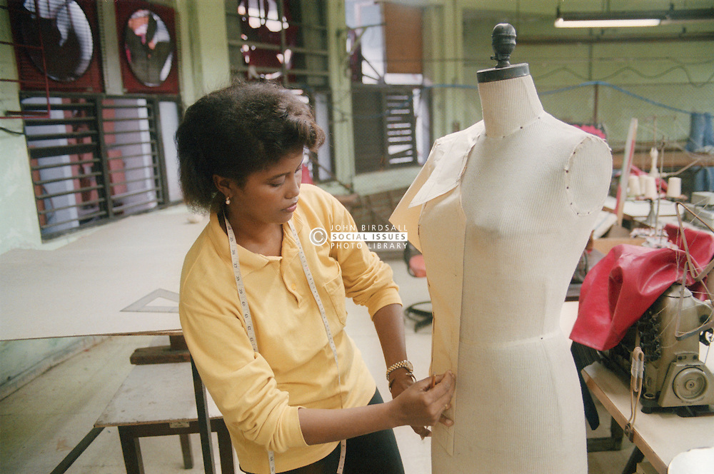 Woman designing clothes in factory in Havana; Cuba,