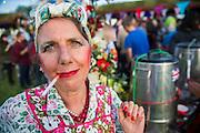 A tea lady in teh interstage area. The 2015 Glastonbury Festival, Worthy Farm, Glastonbury.