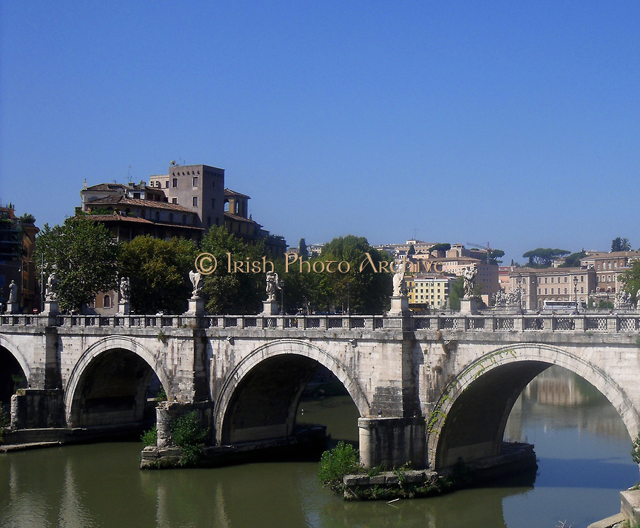 The Ponte Sant'Angelo, (Formerly called the Aelian Bridge) a bridge spanning the Tiber in Rome, Italy. It was completed in 134 AD by Roman Emperor Hadrian, and it links the city centre to his former mausoleum, which is now the Castel Sant'Angelo. the bridge is adorned with colossal statues of angels holding the instruments of passion.