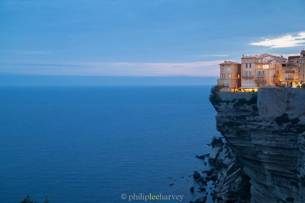 Citadel on cliff and horizon at night, Bonifacio, Corsica, France