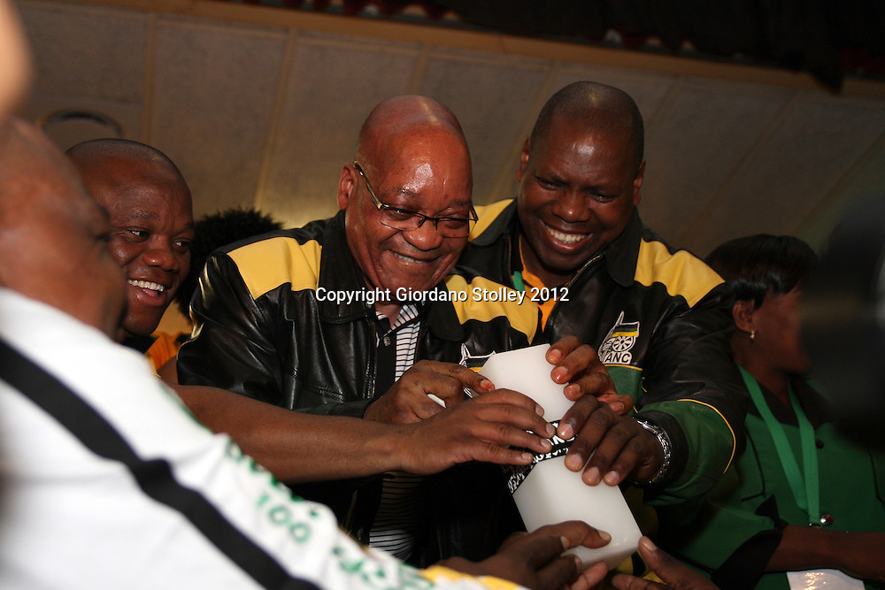 NEWCASTLE - 11 May 2012 - President Jacob Zuma lights the flame for the ANC's fallen heroes at African National Congress' provincial conference as hands reach for the candle. Also in the picture are the ANC's KwaZulu-Natal provincial secretary Sihle Zikalala (left of Zuma) and to the right is the KwaZulu-Natal premier Zweli Mkhize..Picture: Giordano Stolley/Allied Picture Press/APP