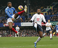 Photo: Lee Earle/Sportsbeat Images.<br /> Portsmouth v Tottenham Hotspur. The FA Barclays Premiership. 15/12/2007. Portsmouth's Sylvain Distin (L) clears from Darren Bent.