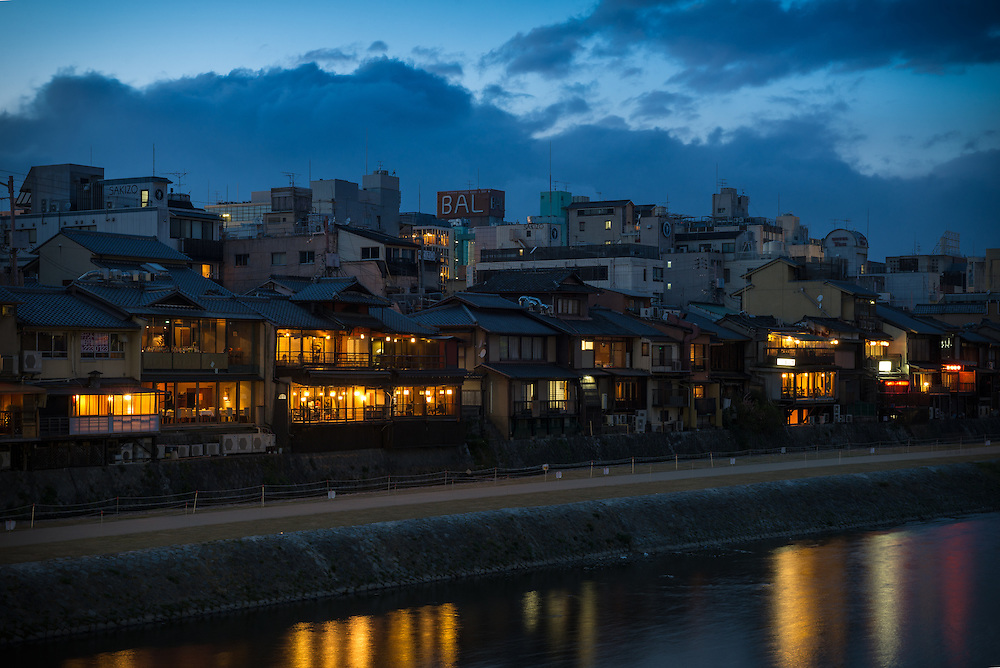 Kamo River and Gion skyline in Kyoto at dusk.