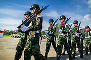 29 SEPTEMBER 2014 - NAKHON NAYOK, NAKHON NAYOK, THAILAND: Thai soldiers march onto the parade ground at Chulalomklao Royal Military Academy during the retirement ceremony for more than 200 Thai generals including Gen. Prayuth Chan-ocha, who led the 22 May coup against the civilian government earlier this year. Prayuth has been chief of the Thai army since 2010. After his retirement, Gen. Prayuth will retain his posts as head of the junta's National Council for Peace and Order (NCPO) and Prime Minister of Thailand. Under Thai law, military officers must retire at 60 years of age. The 200 generals who retired with Prayuth were also his classmates at the Chulalomklao Royal Military Academy in Nakhon Nayok.    PHOTO BY JACK KURTZ