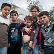 Kids from Iraq outside their tent in Kara Tepe camp, Lesvos, Greece