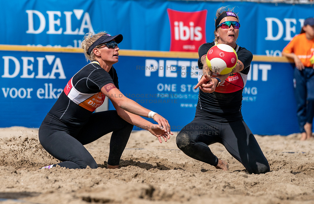 Sanne Keizer (L), Madelein Meppelink in action. The Final Day of the DELA NK Beach volleyball for men and women will be played in The Hague Beach Stadium on the beach of Scheveningen on 23 July 2020 in Zaandam.