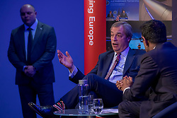 © Licensed to London News Pictures. 29/03/2018. London, UK. Former UKIP Leader Nigel Farage (centre) speaks at 'The UK in a Changing Europe' conference in London on the first anniversary of the triggering of Article 50. Photo credit: Rob Pinney/LNP