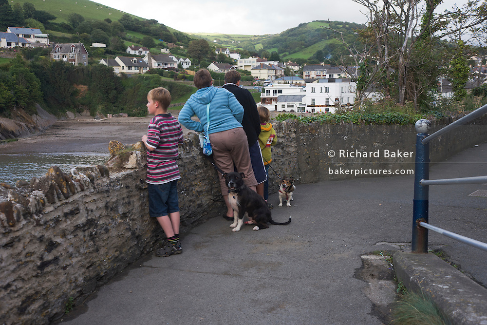 A family have taken their pet dogs along on their holiday to Combe martin in north Devon.
