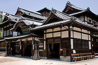 """Dogo Onsen is one of the oldest, some say THE oldest and best-known onsen hot springs in Japan. With a history stretching back over 3000 years, it was a favorite retreat of writer Natsume Soseki when he was working near Matsuyama as a teacher.  In Soseki's loosely autobiographical novel """"Botchan"""", the main character is a frequent visitor to the springs and the only place he likes in the area."""