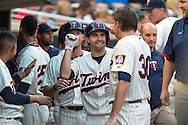 Brian Dozier #2 of the Minnesota Twins celebrates with his teammates in the dugout after hitting a home run against the Chicago White Sox on June 19, 2013 at Target Field in Minneapolis, Minnesota.  The Twins defeated the White Sox 7 to 4.  Photo: Ben Krause