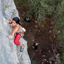 Samira Samimi Szymiec climbing at Prairie Creek in Kananaskis, AB