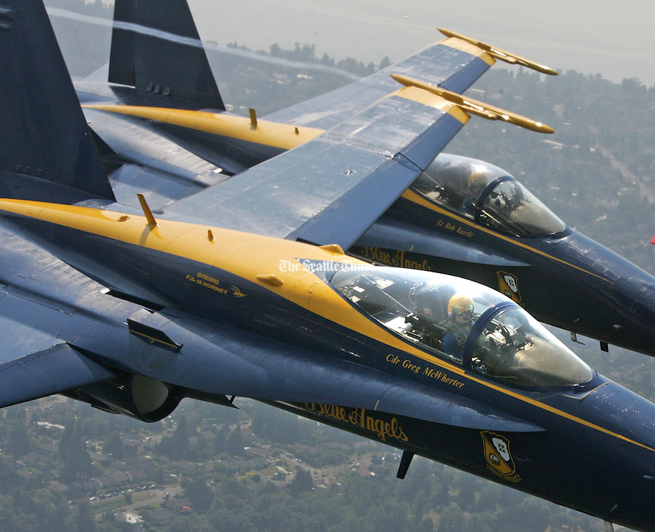 """Team """"Boss"""" Navy CDR Greg McWherter,  foreground, in #1 aircraft, leads Blue Angel Navy LT Rob Kurrle and others in a pass over Seattle and Lake Washington.<br /> Greg Gilbert / The Seattle Times"""