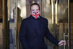© Licensed to London News Pictures. 30/12/2020. London, UK. Health Secretary Matt Hancock leaves television studios near Parliament. The Medicines and Healthcare products Regulatory Agency (MHRA) has authorised the Oxford University Astra Zeneca coronavirus vaccine for use in the UK. Photo credit: Peter Macdiarmid/LNP