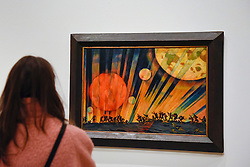 """© Licensed to London News Pictures. 07/02/2017. London, UK. A visitor views """"New Planet"""" by Konstantin Yuon at the preview of an exhibition entitled """"Revolution Russian Art 1917-1932"""", which marks the centenary of the Russian Revolution.  The exhibition runs from 11 February to 17 April 2017 at the Royal Academy of Arts in Piccadilly. Photo credit : Stephen Chung/LNP"""