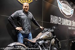 Rainer Baechli, the owner of Harley Heaven Harley-Davidson, in his booth at the Swiss-Moto Customizing and Tuning Show. Zurich, Switzerland. Sunday, February 24, 2019. Photography ©2019 Michael Lichter.