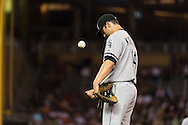 Paul Konerko #14 of the Chicago White Sox tosses a ball during a pause in play against the Minnesota Twins on June 19, 2013 at Target Field in Minneapolis, Minnesota.  The Twins defeated the White Sox 7 to 4.  Photo: Ben Krause