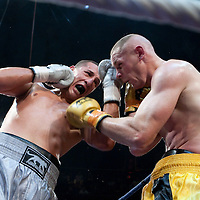 19 November 2009: Light heavyweight fight between Karim Benama (grey trunks) and Thierry Karl (yellow trunks) during the Grand Tournoi boxing semi finals event at Cirque d'Hiver in Paris, France.