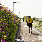 People enjoying the walkway on the Cinta Costera III (Coastal Beltway) on the waterfront of Panama City, Panama, on Panama Bay.