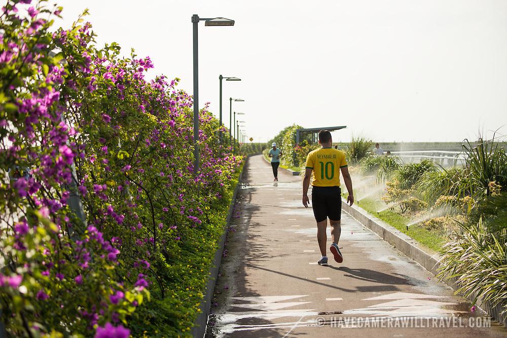 People enjoying the walkway on the Cinta Costera III (Coastal Beltway) on the waterfront of Panama City, Panama, on Panama Bay.