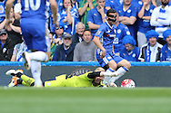 Goalkeeper Kasper Schmeichel of Leicester City attempts to save  from Pedro of Chelsea. Barclays Premier league match, Chelsea v Leicester city at Stamford Bridge in London on Sunday 15th May 2016.<br /> pic by John Patrick Fletcher, Andrew Orchard sports photography.