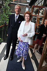 MR CHRISTOPHER BALFOUR and LADY ELIZABETH ANSON at a reception hosted by the Friends of the Castle of Mey held at the Goring Hotel, Beeston Place, London on 22nd May 2012.