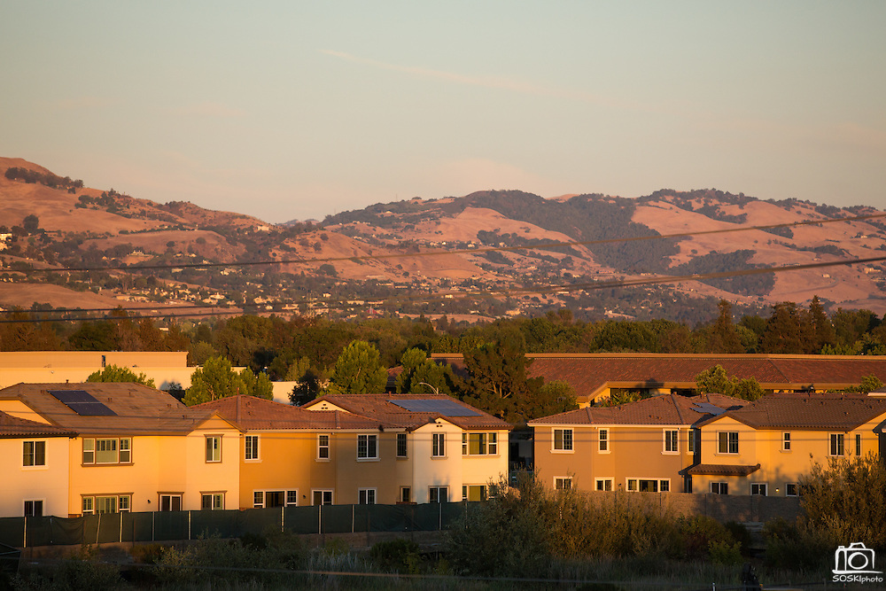 Town home construction continues near City Hall and Wells Fargo Bank in Milpitas, California, on July 21, 2014. (Stan Olszewski/SOSKIphoto)