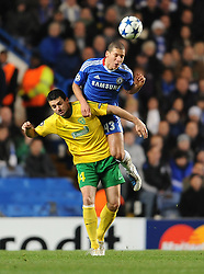 23.11.2010, Stamford Bridge, London, ENG, UEFA CL, Chelsea FC vs MSK Zilina, im Bild Chelsea`s Jeffrey Bruma leaps with Zalina's Tomas Oravec  Chelsea vs MSK Zilina  for the  Uefa Champions Premier League, Group H,  at Stamford Bridge stadium in London on 23/11/2010. EXPA Pictures © 2010, PhotoCredit: EXPA/ IPS/ Rob Noyes +++++ ATTENTION - OUT OF ENGLAND/UK and FRANCE/FR +++++