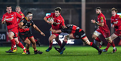Scarlets' Dan Jones is tackled by Dragons' Taine Basham<br /> <br /> Photographer Craig Thomas/Replay Images<br /> <br /> Guinness PRO14 Round 13 - Scarlets v Dragons - Friday 5th January 2018 - Parc Y Scarlets - Llanelli<br /> <br /> World Copyright © Replay Images . All rights reserved. info@replayimages.co.uk - http://replayimages.co.uk
