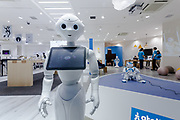 Softbank's emotional consumer Robot, Pepper on display at the Softbank Store Omotesando, Tokyo, Japan. Friday October 24th 2014.  At the end of June 2021 the Softbank company announced it was cutting jobs in its global robotics business and had stopped production of the Pepper robot.