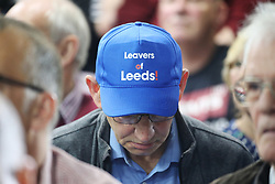A Brexit supporter wears a 'Leavers of Leeds' cap during a rally at Featherstone Working Man's Club, while on the European Election in Pontefract, West Yorkshire. Picture dated: Monday May 13, 2019. Photo credit should read: Isabel Infantes / EMPICS Entertainment.