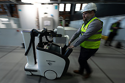© Licensed to London News Pictures. 09/04/2020. Manchester, UK. A brand new portable x-ray scanner is delivered to the hospital . The National Health Service is building a 648 bed field hospital for the treatment of Covid-19 patients , at the historical railway station terminus which now forms the main hall of the Manchester Central Convention Centre . The facility is due to open on Easter Monday , 13th April 2020 , and will treat patients from across the North West of England , providing them with general medical care and oxygen therapy after discharge from Intensive Care Units . Photo credit: Joel Goodman/LNP