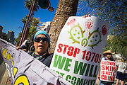 25 JUNE 2012 - PHOENIX, AZ:  ATLI MEXITA chants on the street in front of the Immigration and Customs Enforcement (ICE) offices in central Phoenix Monday. About 100 immigration supporters held a protest against ICE and continued deportations by the Obama administration. Protesters also celebrated the US Supreme Court decision to overturn most of SB1070, Arizona's tough anti-immigration law.      PHOTO BY JACK KURTZ