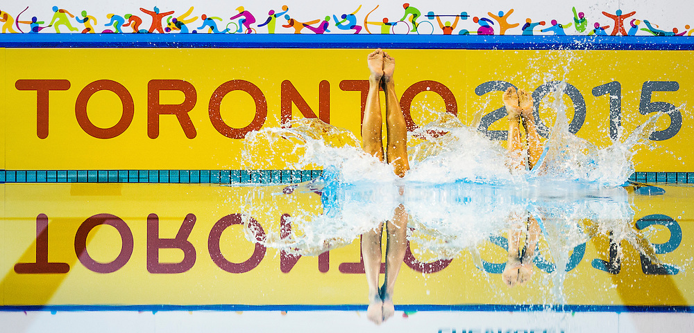 Brazil's Luisa Borges and Maria Eduarda De Souza perform during the Duet Synchronized Swimming technical routine at the Pan American Games in Toronto, Thursday July 9, 2015.    THE CANADIAN PRESS/Mark Blinch