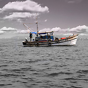 Old fishing boat in the open sea