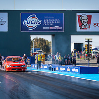 Stuart Moresby (1999) (Ford BF Falcon XR8 Ute( and Tracey De Jager (2129) (Ford Thunderbird) face off in Supercharged Outlaws.