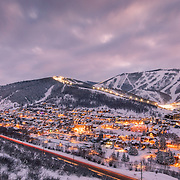 A busy Park City Mountain Resort, Main Street, and Deer Valley ignite just after sunset. 2016