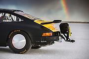 Image of a black 1975 Porsche 911 streamliner with a rainbow, Bonneville Salt Flats, World of Speed 2014, Utah, American Southwest by Randy Wells