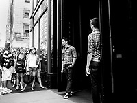 Shoppers lined up while bouncers guard the door at the Abercrombie & Fitch store on Fifth Avenue, New York City.