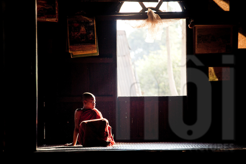 Young buddhist monks sits in a monastery of Kalaw, Myanmar, Asia