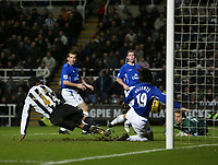 Photo: Andrew Unwin.<br />Newcastle United v Everton. The Barclays Premiership. 25/02/2006.<br />Newcastle's Nolberto Solano (L) fires home his team's first goal.