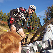 Lester Perry falls from his bike and clatters into photographers during the thrills and spills of the New Zealand Cyclocross Championships sponsored by AJ Hackett Bungy, held at Jardine Park,  Queenstown, as part of the Queenstown WInter Festival. The men's event was won by Dan Warren from Hastings while Anja McDonald from Dunedin won the women's event. Queenstown, New Zealand, 2nd July 2011