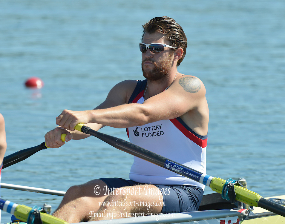 Varese,  ITALY. 2012 FISA European Championships, Lake Varese Regatta Course. ..GBR M4X. Bow Dan RITCHIE,  at the start of their heat of the Men's Quadruple Sculls Four...{TIME  {DOW}  14/09/2012.....[Mandatory Credit Peter Spurrier:  Intersport Images]  ..2012 European Rowing Championships ..Rowing, European,  2012 010757.jpg....