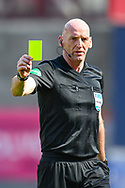 Referee Bobby Madden awards a yellow card during the SPFL Championship match between Heart of Midlothian and Inverness CT at Tynecastle Park, Edinburgh Scotland on 24 April 2021.