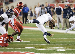 September 16, 2017 - Houston, TX, USA - Rice Owls quarterback Sam Glaesmann (4) is tripped up by Houston Cougars cornerback Jeremy Winchester (24) causing a fumble during the second quarter of the college football game between the Houston Cougars and the Rice Owls at TDECU Stadium in Houston, Texas. (Credit Image: © Scott W. Coleman via ZUMA Wire)