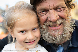 Rich Rau with his granddaughter at the hosted stop in The Dales Oregon on the Motorcycle Cannonball coast to coast vintage run. Stage 14 (303 miles) from Spokane, WA to The Dalles, OR. Saturday September 22, 2018. Photography ©2018 Michael Lichter.