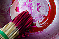 Just-dyed sticks of incense sit in a bowl in a workshop, Pleiku, Gia Lai Province, Vietnam, Southeast Asia