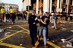 File photo dated 31/03/1990 of a protester led away by police after a protest against the so-called poll tax, as Prime Minister John Major's desperate, as Prime Minister John Major's desperate efforts to placate a furious Margaret Thatcher after she turned against him just weeks after he entered No 10 are laid bare in newly released government files.